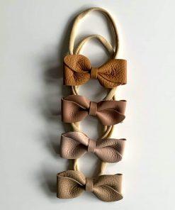 nylon haarbandje met leren strik van bonbon